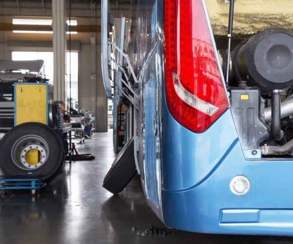 bus and truck waiting for service in the garage